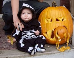 Adorable great nephew with pumpkin carved by his dad.